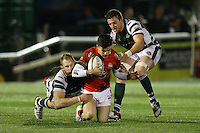 Glyn Hughes of London Welsh is tackled by Mark Bright (Capt) of Ealing Trailfinders (left) and Arthur Ellis of Ealing Trailfinders right during the Greene King IPA Championship match between Ealing Trailfinders and London Welsh RFC at Castle Bar , West Ealing , England  on 26 November 2016. Photo by David Horn / PRiME Media Images