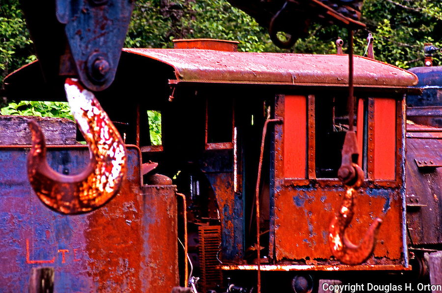 Classic train photo.  Antique Steam Engine and coal car with freight hook in foreground.