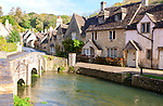Bybrook River running past stone cottages in Castle Combe, Wiltshire, England, UK claimed to be England's prettiest village