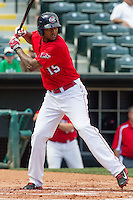 Oklahoma City RedHawks right fielder Domingo Santana (15) at bat during the Pacific League game at the Chickasaw Bricktown Ballpark against the New Orleans Zephyrs on April 13, 2014 in Oklahoma City, Oklahoma.  The RedHawks defeated the Zephyrs 4-3.  (William Purnell/Four Seam Images)