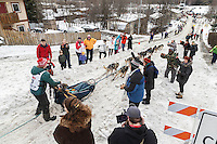 Kristin Knight Pace runs down Cordova Street hill past  spectators during the Ceremonial Start of the 2016 Iditarod in Anchorage, Alaska.  March 05, 2016