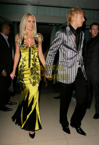 EMMA NOBLE & RICK PARFITT.The Laurent-Perrier Pink Party, Suka, Sanderson Hotel, London, England..April 25th, 2007.full length black floral print green satin dress trousers grey gray striped stripes jacket couple profile holding hands .CAP/AH.©Adam Houghton/Capital Pictures