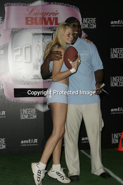 Nikki Ziering &amp; Eric Dickerson<br />Lingerie Bowl Kicks Off With a Star Studded Practice <br />Jackie Robinson Stadium<br />Los Angeles, CA, USA<br />December 2, 2003 <br />Photo By Celebrityvibe.com /Photovibe.com