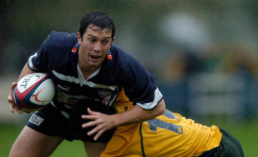 Photo: Richard Lane..Henley Hawks v Bristol Shoguns. Division One. 23/10/2004..Jon Pritchard is tackled.