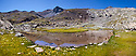 Mountain lake with Pic de Campbieil (3173 metres) in the background, digitally stitched panorama, Hautes-Pyrenees, Midi-Pyrenees,  Pyrenees, France. August.