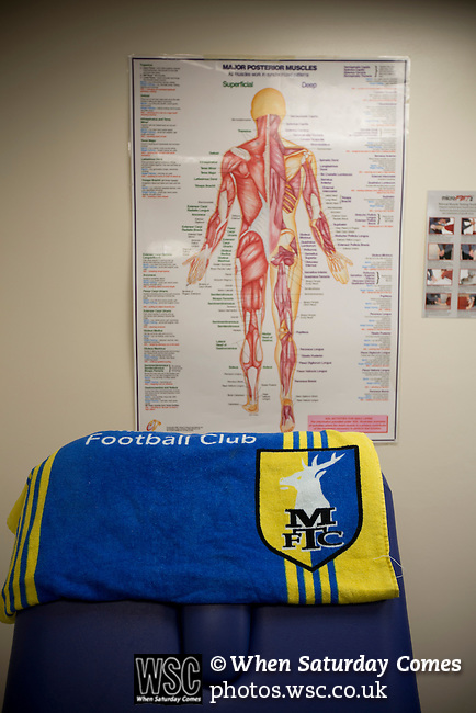 Mansfield Town Football Club Open Day, 14/07/2013. Field Mill stadium, League Two. A towel with a club crest in the physio's room at Mansfield Town's Field Mill stadium during an open day held for the club's supporters. Mansfield Town achieved promotion back to England's Football League by winning the Conference National in season 2012-13. Field Mill was the oldest ground in the Football League, hosting football since 1861 although some reports date it back as far as 1850, with Mansfield Town having played there since 1919. Photo by Colin McPherson.