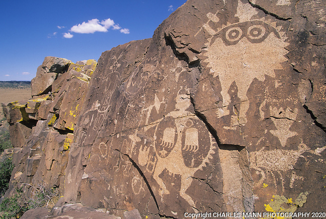 Petroglyphs of wide eyed shield men lend a dramatic sense of a past culture to a volcanic outcropping in the Galesteo River Basin near the village of Galesteo,New Mexico, a few miles from Santa Fe.