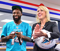 MIAMI, FL - SEPTEMBER 20: Miami Dolphins Wide Receiver (#14) Jarvis Landry and BankUnited Senior Vice President Marketing and Public Relations Mary Harris surprise the Miramar Patriots varsity football team prior to the teamís practice as part of the 4 Downs for Finance financial literacy program sponsored by BankUnited. Landry share his thoughts on the importance of financial literacy at Miramar High School Media Center on September 20, 2016 in Miramar, Florida.  Credit: MPI10 / MediaPunch