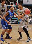 SIOUX FALLS, SD - MARCH 10:  Duke Mondy #20 of Oakland University shields the ball from Pierre Bland #2 of IPFW during their quarterfinal game at the 2013 Summit League Basketball Championships at the Sioux Falls Arena Sunday. (Photo by Dick Carlson/Inertia)