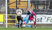 Jason McCarthy of Wycombe Wanderers blocks a Adam Campbell of Notts County attempt during the Sky Bet League 2 match between Notts County and Wycombe Wanderers at Meadow Lane, Nottingham, England on 28 March 2016. Photo by Andy Rowland.