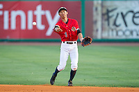 Charleston RiverDogs second baseman Gosuke Katoh (4) makes a throw to first base against the Greenville Drive at Joseph P. Riley, Jr. Park on May 26, 2014 in Charleston, South Carolina.  The Drive defeated the RiverDogs 11-3.  (Brian Westerholt/Four Seam Images)
