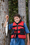 Theo Marshall, Age 9 with Rainbow Trout caught at Murtle Lake in Wells Gray Provincial Park, B.C.  Spruce tree