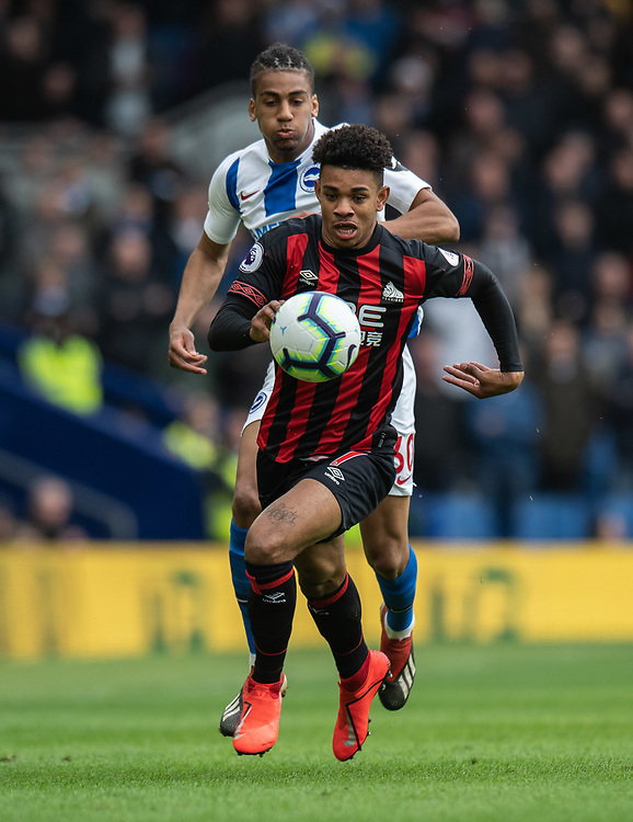Huddersfield Town's Juninho Bacuna (right) under pressure from Brighton & Hove Albion's Bernardo (left) <br /> <br /> Photographer David Horton/CameraSport<br /> <br /> The Premier League - Brighton and Hove Albion v Huddersfield Town - Saturday 2nd March 2019 - The Amex Stadium - Brighton<br /> <br /> World Copyright © 2019 CameraSport. All rights reserved. 43 Linden Ave. Countesthorpe. Leicester. England. LE8 5PG - Tel: +44 (0) 116 277 4147 - admin@camerasport.com - www.camerasport.com