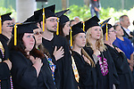 Graduates listen to the Star Spangled Banner during the 2015 Western Nevada College Commencement held at the Pony Express Pavilion in Carson City, Nev., on Monday, May 18, 2015.<br /> Photo by Tim Dunn