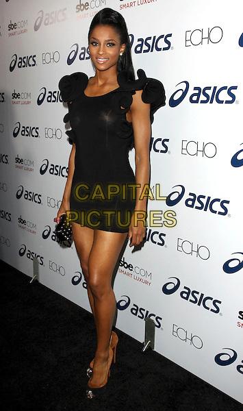 CIARA (Ciara Princess Harris).Attending The ASICS Celebration for Leona Lewis' Album, held At Hyde Lounge, West Hollywood, California, USA, 17th November 2009..full length black dress ruffle wavy shoulders gold toe shoes christian suede heels Louboutin mini clutch bag two tone brown .CAP/ADM/KB.©Kevan Brooks/AdMedia/Capital Pictures.