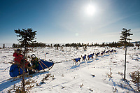 Sebastian Schnuelle runs on the outbound trail after leaving the Koyuk checkpoint in Arctic Alaska during teh 2010 Iditarod