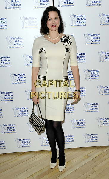 JASMINE GUINNESS.The White Ribbon Alliance's Global Dinner Party Campaign, Agua, Sanderson Hotel, London, England. .March 4, 2010 .full length white grey gray dress black tights beige shoes bag purse striped stripes .CAP/CJ.©Chris Joseph/Capital Pictures.