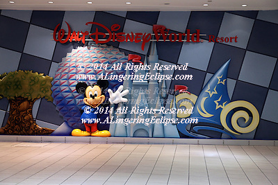 Mickey Mouse Waves I -- Walt Disney Logo, Orlando International Airport, Epcot, Castle, Relief Sculpture Greets Visitors As They Arrive in Florida