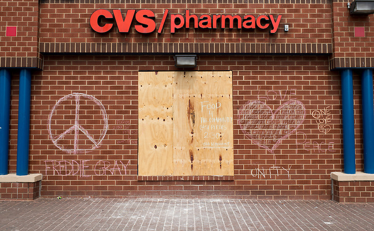 UNITED STATES - MAY 5: Messages written in chalk decorate the outside of the burned out and looted CVS, next to the Penn North Plaza senior living facility, in Baltimore on Tuesday, May 5, 2015. (Photo By Bill Clark/CQ Roll Call)