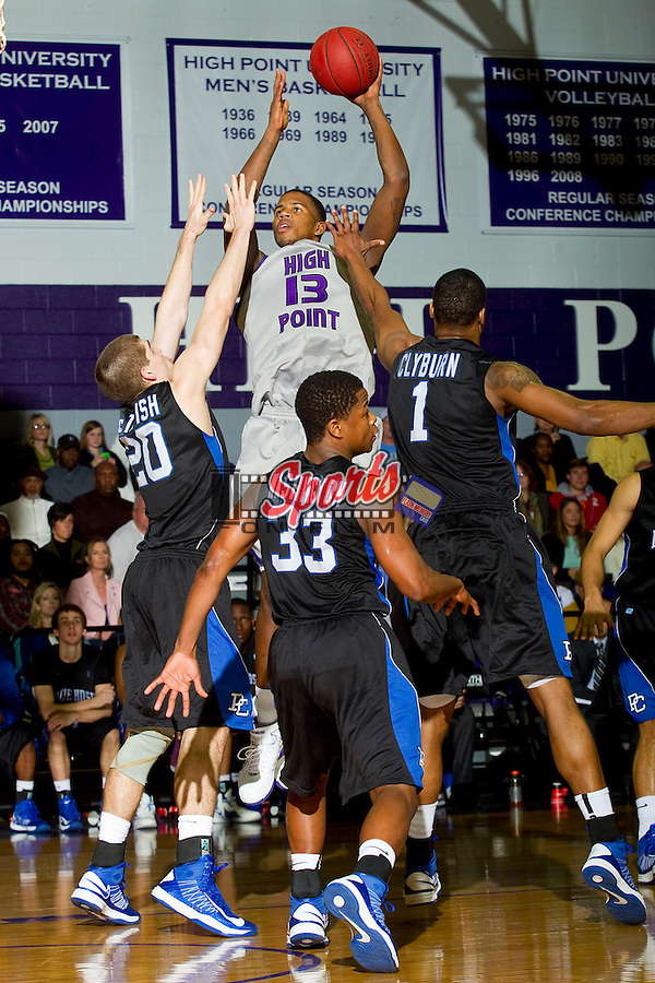 Allan Chaney (13) of the High Point Panthers rises up to shoot over Ryan McTavish (20) and Joshua Clyburn (1) of the Presbyterian Blue Hose during first half action at Millis Athletic Center on February 2, 2013 in High Point, North Carolina.  The Panthers defeated the Blue Hose 67-59.   (Brian Westerholt/Sports On Film)
