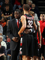 Dec. 22, 2010; Charlottesville, VA, USA; Seattle Redhawks head coach Cameron Dollar hugs Seattle Redhawks guard Mark McLaughlin (32) during the game at the John Paul Jones Arena. Seattle Redhawks won 59-53. Mandatory Credit: Andrew Shurtleff