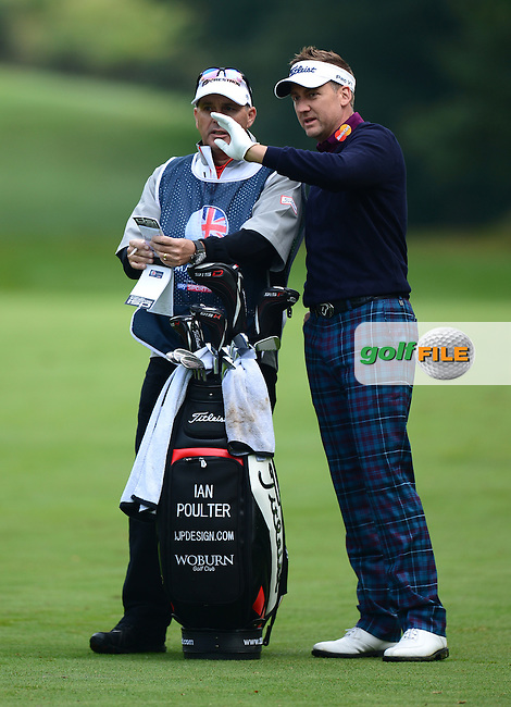 Ian Poulter of England looks on with his caddie during Round 4 of the 2015 British Masters at the Marquess Course, Woburn, in Bedfordshire, England on 11/10/15.<br /> Picture: Richard Martin-Roberts | Golffile