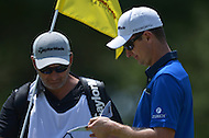 Bethesda, MD - June 28, 2014: Justin Rose consults with his caddie before a shot in Round 3 of the Quicken Loans National at the Congressional Country Club in Bethesda, MD, June 28, 2014.  (Photo by Don Baxter/Media Images International)