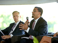 NWA Democrat-Gazette/BEN GOFF @NWABENGOFF<br /> Mike Malone (left), president and CEO of the Northwest Arkansas Council, listens as John King, Jr., deputy U.S. Secretary of Education, speaks on Thursday Sept. 17, 2015 during a panel discussion on early childhood development at the future site of a new Helen R. Walton Children's Enrichment Center and Early Childhood Initiatives Center on N.E. J St. in Bentonville.