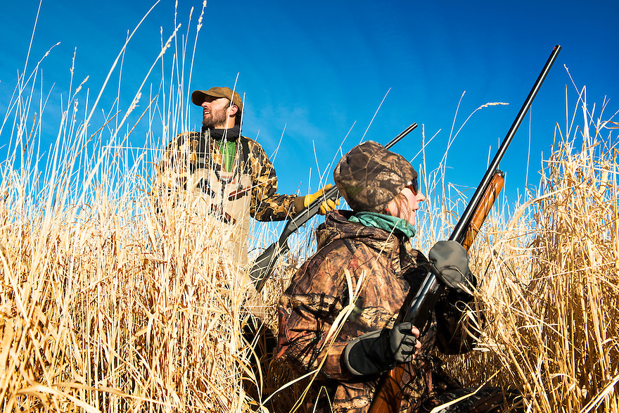 Nick Romano, left, and Christine Marozick, of Bozeman, Montana, waterfowl hunt near Clark Canyon Reservoir near Dillon, Montana.