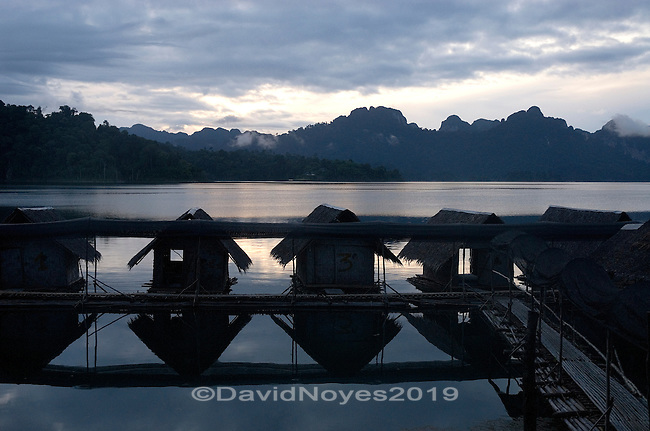 Floating bamboo bungalows located in a remote area of the Khao Sok National Park in southern Thailand are temporary homes to explore the largest protected forest on the Thai-Malaysian peninsula. Bamboo and thatched roofs provide a very simple, environmentally friendly shelter.
