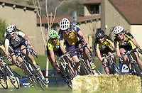 Collegiate women cyclists race in a criterium event at Fort Lewis College in Durango, Colorado in  April 2003.