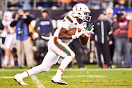 Charlotte, NC - DEC 2, 2017: Miami Hurricanes running back DeeJay Dallas (13) returns the kickoff during ACC Championship game between Miami and Clemson at Bank of America Stadium Charlotte, North Carolina. (Photo by Phil Peters/Media Images International)