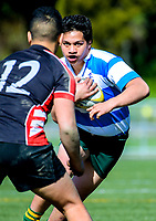 Action from the Hurricanes under-15 rugby tournament match between Wanganui High School (white and sky blue hoops) and Manukura College (red white and black) at Maidstone Park in Upper Hutt, Wellington, New Zealand on Thursday, 7 September 2017. Photo: Dave Lintott / lintottphoto.co.nz