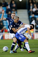 Steve Morison of Millwall gets hands on with Maxime Colin of Birmingham City during the Sky Bet Championship match between Millwall and Birmingham City at The Den, London, England on 21 October 2017. Photo by Carlton Myrie.