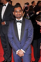 Aziz Ansari at the 'Schiaparelli And Prada: Impossible Conversations' Costume Institute Gala at the Metropolitan Museum of Art on May 7, 2012 in New York City. © mpi03/MediaPunch Inc.