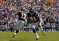 Sept. 17, 2006; San Diego, CA, USA; San Diego Chargers running back (21) LaDainian Tomlinson runs after taking the handoff from quarterback (17) Phillip Rivers against the Tennessee Titans at Qualcomm Stadium in San Diego, CA. Mandatory Credit: Mark J. Rebilas