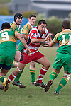 Ross Turnbull looks to push off Leon Serfontein as he tries to break the Drury line. Counties Manukau Club rugby Premier game between Drury and Karaka played at Drury on Saturday May 1st, 2010. Karaka won the game 32 -12 after leading 25 - 7.