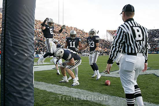 BYU's Andrew George (88, bottom left) is surrounded by teammates celebrating his fourth quarter touchdown. BYU vs. Air Force college football Saturday, November 21 2009.