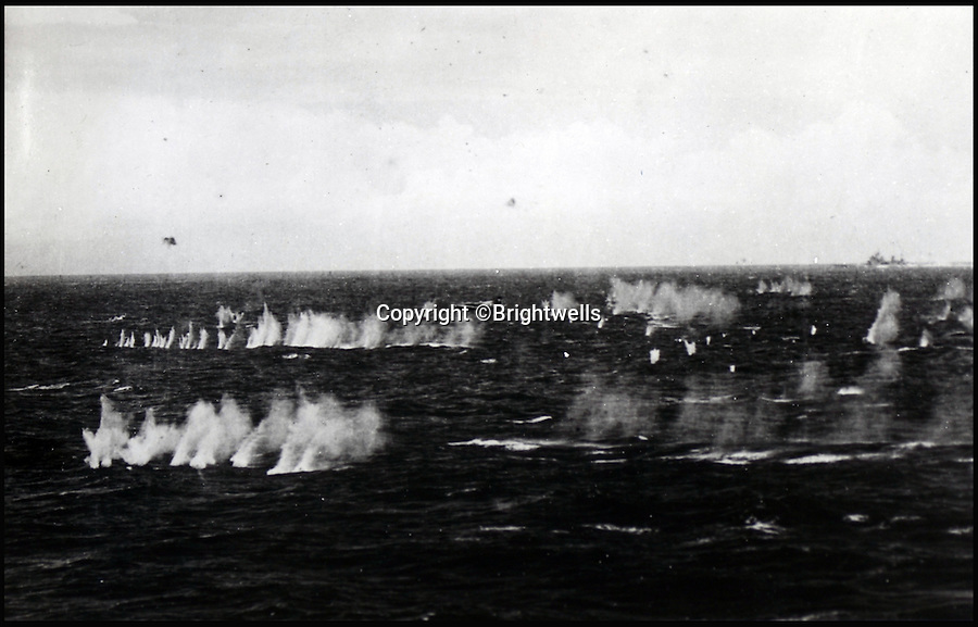 BNPS.co.uk (01202 558833)<br /> Pic: Brightwells/BNPS<br /> <br /> The shooting down of Japanese suicide planes.<br /> <br /> A remarkable photo album showing the brutal aftermath of Kamikaze attacks and crash landings on Allied aircraft carriers in the Second World War has been uncovered after 70 years.<br /> <br /> The 112 original photographs of the Royal Navy Pacific Fleet in 1945 include a host of images showing the flaming wreckage of Japanese planes that were deliberately flown into the superstructure of ships by suicidal pilots.<br /> <br /> There are also harrowing photos of US fighter planes bursting into flames on landing on the flight deck as well as one crashing into the sea.<br /> <br /> The album is being sold by Brightwells Auctioneers in Herefordshire.