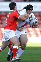 PICTURE BY ALEX WHITEHEAD/SWPIX.COM - Rugby League - Autumn International Series - Wales vs England - Glyndwr University Racecourse Stadium, Wrexham, Wales - 27/10/12 - England's Chris Hill is tackled by Wales' defence.