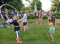 NWA Democrat-Gazette/BEN GOFF &bull; @NWABENGOFF<br /> Children play with hula hoops on Friday Aug. 7, 2015 during the Back to School Celebration First Friday on the Bentonville square.
