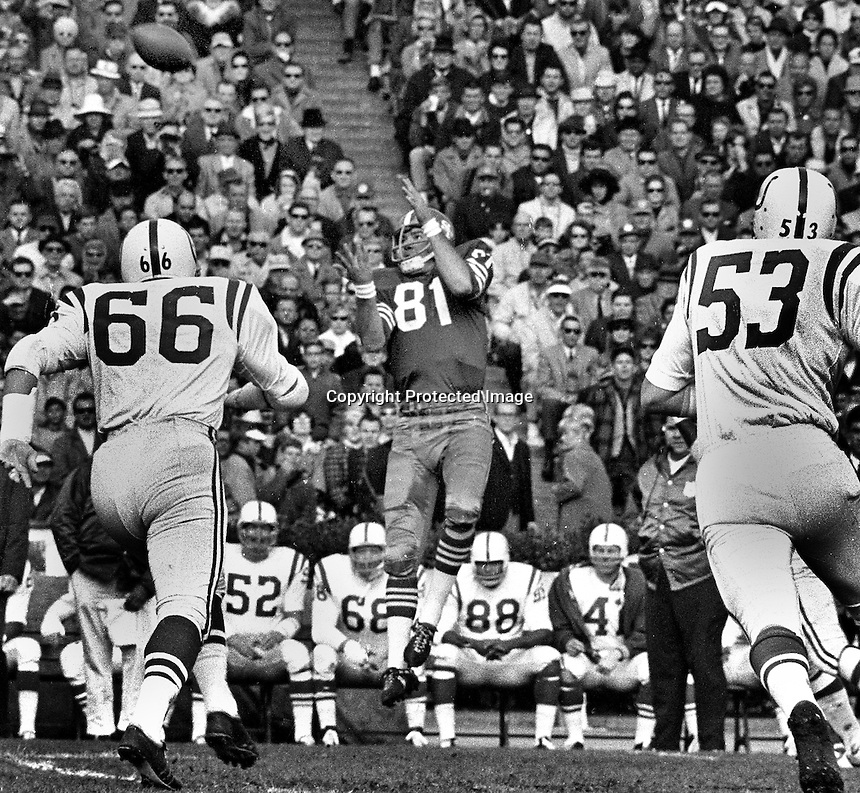 San Francisco 49ers Dave Parks leaps to grab pass from John Brodie, against the Baltimore Colts. (1966 <br />photo by Ron Riesterer)