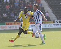 Isaac Osbourne pressures Sammy Clingan in the Kilmarnock v St Mirren Scottish Professional Football League Premiership match played at Rugby Park, Kilmarnock on 13.9.14.