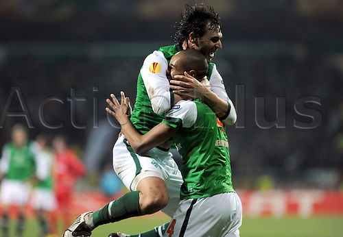 Bremen's Naldo (R) celebrates his 3-0 score with teammate Hugo Almeida during the Europa League last 32 second leg match Werder Bremen vs Twente Enschede at Weser stadium in Bremen, Germany, 25 February 2010. German Bundesliga club Bremen defeated Dutch side Enschede 4-1 and goes on to the round of the last 16. Photo: Carmen Jaspersen /Actionplus. Editorial Use UK.