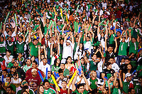 Fans cheer and partake in the wave as Mexico played Colombia in an exhibition game at the Cotton Bowl in Dallas, Texas, USA, Wednesday, Sept., 30, 2009. Colombia won the game 2-1, which was played as the second game of a double header after an FC Dallas soccer game in an attempt by Major League Soccer to draw a new crowd of hispanic people to the sport in the US...PHOTOS/ MATT NAGER