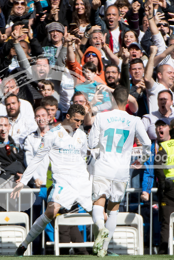 Real Madrid's Portuguese forward Cristiano Ronaldo celebrates after scoring<br /> Spanish league football match Real Madrid vs Atletico de Madrid at the Santiago Bernabeu stadium in Madrid on April 8, 2018.