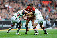 Ernst Joubert of Saracens is tackled by Rory Clegg (left) and Rob Buchanan of Harlequins during the Aviva Premiership match between Saracens and Harlequins at Wembley Stadium on Saturday 31st March 2012 (Photo by Rob Munro)