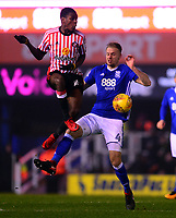 Joel Asoro of Sunderland wins the ball in the air against Marc Roberts of Birmingham during the Sky Bet Championship match between Birmingham City and Sunderland at St Andrews, Birmingham, England on 30 January 2018. Photo by Bradley Collyer / PRiME Media Images.