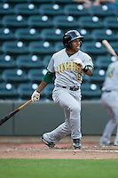Greg Allen (9) of the Lynchburg Hillcats follows through on his swing against the Winston-Salem Dash at BB&T Ballpark on April 28, 2016 in Winston-Salem, North Carolina.  The Dash defeated the Hillcats 4-1.  (Brian Westerholt/Four Seam Images)