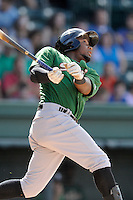 Right fielder John Mora (4) of the Savannah Sand Gnats, bats in a game against the Greenville Drive on Sunday, July 5, 2015, at Fluor Field at the West End in Greenville, South Carolina. Savannah won, 8-6. (Tom Priddy/Four Seam Images)